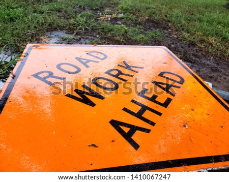 Road Work Ahead sign fallen due to weather.  #1410067247