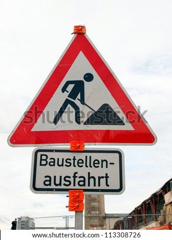 Road works sign for construction works in progress - in German