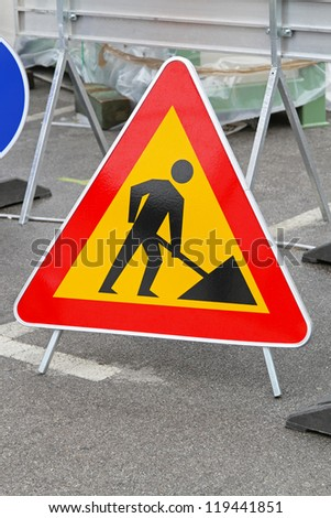 Road works triangular traffic sign at construction site
