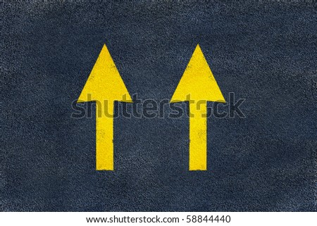 road yellow marking of arrows on asphalt