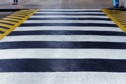 Road zebra crossing with speed bump. Defocused photo with soft focus.