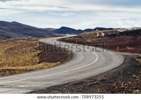 Road zigzag in the volcanic mountains of Iceland #708973255