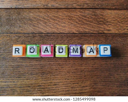 Roadmap text colorful letters on wood background, flat layout #1285499098