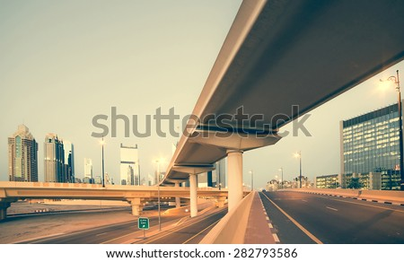 Roads and bridge at the Sheikh Zayed Road in Dubai in the evening, United Arab Emirates #282793586