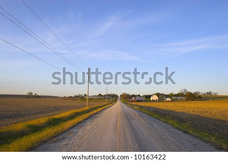 Roads in countryside surrounded by colorful fields and meadows