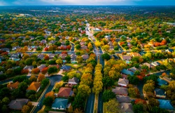 roads leas to suburbia fall Autumn suburb suburbia round Rock Texas colorful landscape trees changing colors fall in central texas