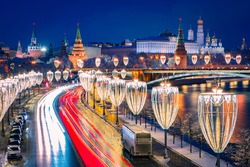 Roads of Moscow. Capital of Russia. Panorama of Moscow from a quadcopter. Long exposure photographs of a winter road. Highway in center of Moscow. Lanterns are decorated with Christmas illumination.