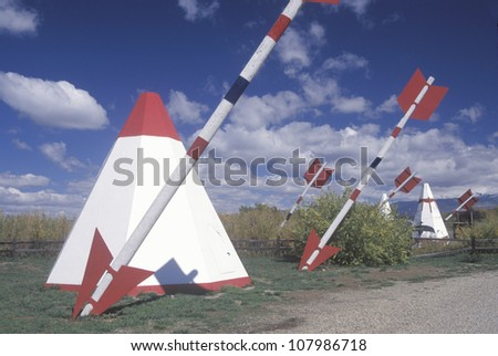 Roadside attraction of tepees & giant arrows on Navajo Tribal Land, CO