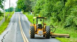 Roadside mowing by county maintenance worker near intercourse, PA.