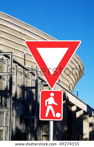 Roadside pedestrian sign with a soccer ball in front of the Greenpoint stadium in Cape Town.