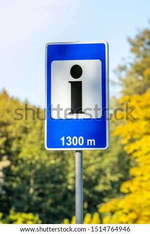 Roadside sign for passing tourists directions to visitor information centre #1514764946