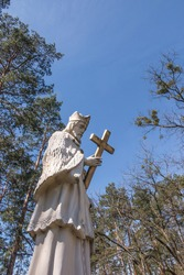 Roadside statue of St. John of Nepomuk at the Zielona pond in Kalety on the Mala Panew river in Poland. It is a patron who saves from flooding.