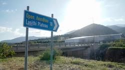 Roadsign leading the way to Lasithi Plateau near Malia on Crete Island, Greece.