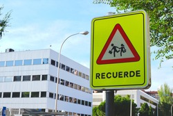 Roadsign protecting kids from cars hazard on the street of Madrid, Spain. Word on traffic sign in Spanish means