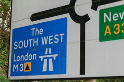 Roadsign showing motorway to London and the South West