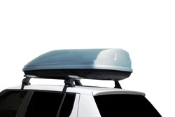 Roadster Car With Trunk Box Isolated On White Background. SUV Car Roof With Luggage Box On Rooftop On The Rack System Isolated. Closeup Of Roadster Car Roof Box And Rack System On Rooftop.