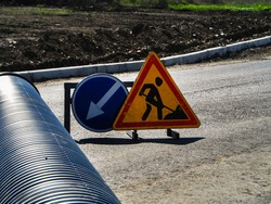 Roadworks sign. Mandatory signs. Permited directions.