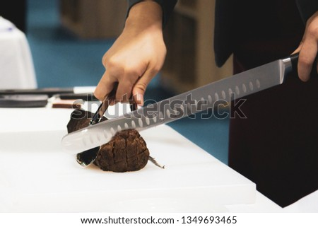 Roast beef and slice, chef's hands cutting roast beef, Carving roast beef