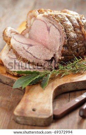 Roast beef and spices on the wooden cutting board