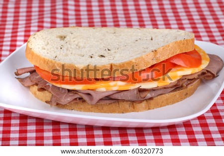 Roast beef, cheese and tomato on rye bread sandwich