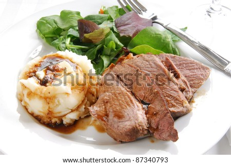 Roast beef dinner with spinach salad