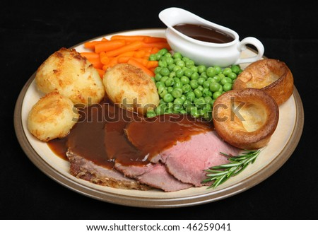 Roast beef dinner with Yorkshire pudding and individual gravyboat.