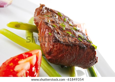 roast beef fillet served with tomato on white