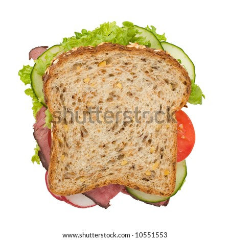 Roast beef sandwich with lettuce, tomatoes, cucumbers and radishes isolated on white, top view