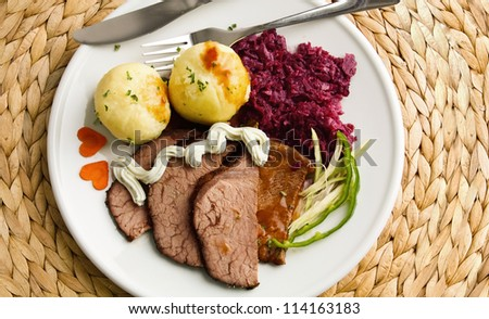 Roast beef with potato dumplings and red cabbage