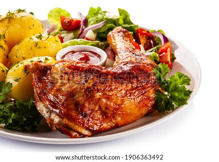 Roast chicken leg with boiled potatoes on white background  Stock fotó ©