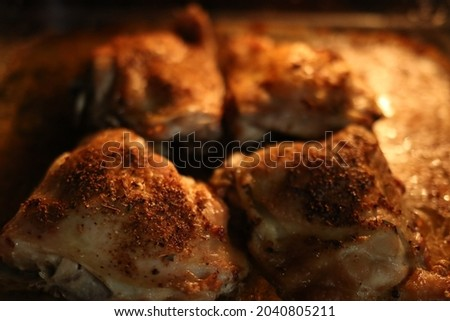 Roast chicken legs in the stove. Delicious meal for dinner. Hot chicken in the stove with spice Stock fotó ©