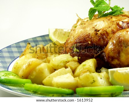 Roast chicken whit potatoes and salad