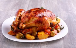 Roast chicken with brussel sprouts, carrot and potato