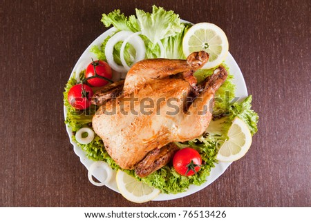 Roast chicken with fresh vegetables, studio shot - stock photo