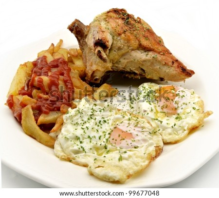 Roast chicken with potatoes and fried eggs