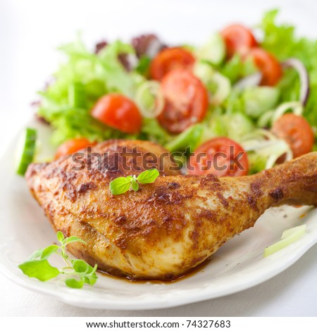Roast chicken with salad and fresh herbs