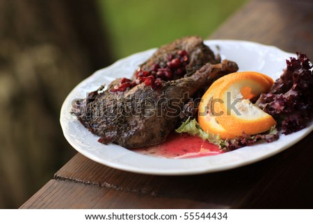 Roast duck and orange with pomegranate gravy at restaurant