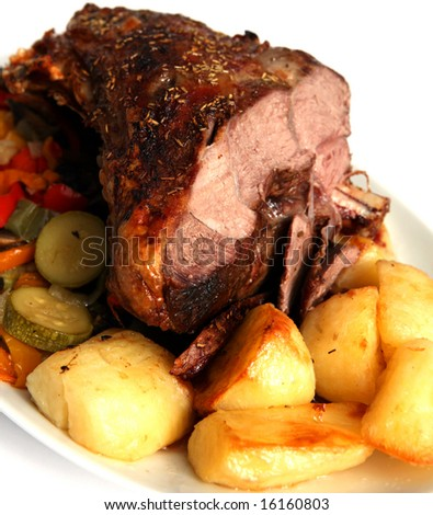 Roast herb-coated lamb  with roasted potatoes and stir-fried vegetables