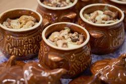 Roast in brown ceramic pots