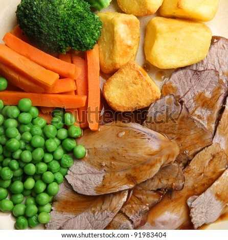 Roast lamb dinner with vegetables and gravy
