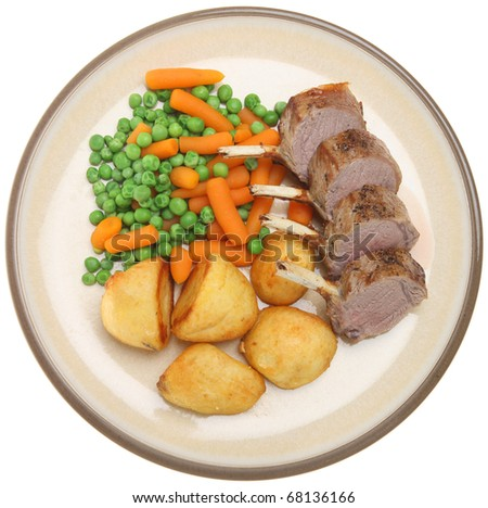 Roast lamb with roast potatoes, peas and carrots.