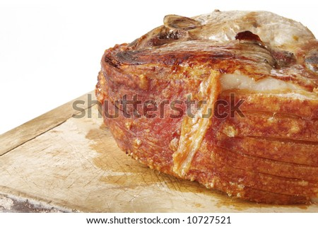 Roast leg of pork, ready for carving.  With yummy crackling.