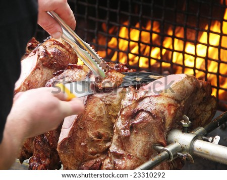 roast meat by fire with flames, traditionally eaten at different family feast