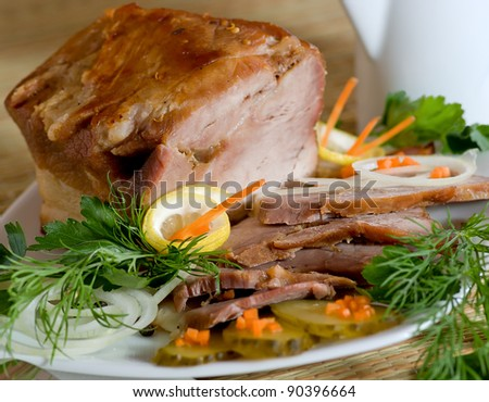 Roast meat in beer with vegetables and lemon - stock photo