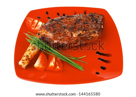 roast meat shoulder on red with tomatoes chives and green lettuce isolated on white