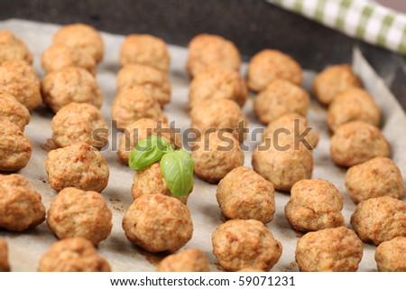 Roast meatballs on baking sheet. Shallow DOF