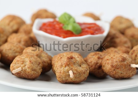 Roast meatballs on skewers and tomato dip. Shallow DOF