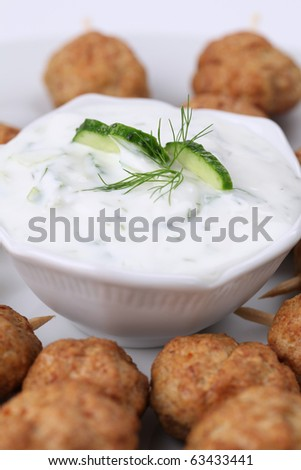Roast meatballs on skewers and tzatziki dip. Shallow DOF