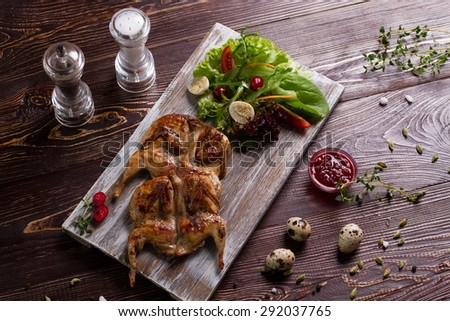 Roast quails with vegetable salad. Beautiful and delicious luxury dish.