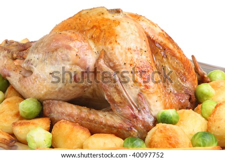 Roast turkey with roast potatoes, parsnips and sprouts